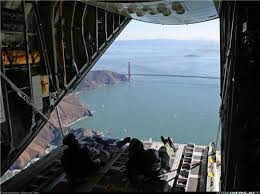 the view of two coast guard men reclined in the back of a large plane with best office in the world