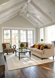 updated farmhouse ceiling with beams paneling fresh white creates expansive light and airy ambiance cathedral ceiling lighting ideas