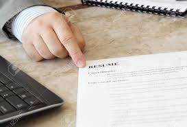 job interview in the office male hand and resume on the job interview in the office male hand and resume on the table stock photo