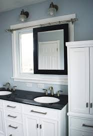 sliding bathroom mirror: bathroom remodel sliding mirror tall linen cabinet by since i became a mom