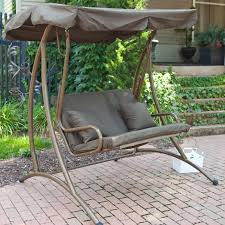 brown metal based outdoor swing chair with gray upholstered craddle and canopy with porch swing with brown covers outdoor patio