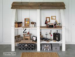 upcycled dollhouse bookshelf with handmade furniture from wood scraps and thrift store finds funkyjunkinteriors bookcase dolls house emporium