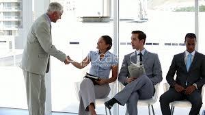 businessman welcoming interviewee royalty video and stock clips businessman welcoming interviewee