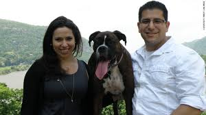 Michelle Przybyksi      and Andy Lalinde      pose with their dog Domino CNN com