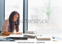 essay stock photos royalty free images amp vectors   shutterstock beautiful student writing an essay in a library