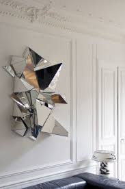 mirror wall decor circle panel: froisse mirror by mathias kiss the froissac mirror resembles crumpled paper and was handcrafted with pieces of broken mirror assembled on a wooden base
