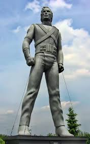 top ideas about michael jackson biography silver colored statue of jackson standing up his arms bent inward and both legs spaced apart one of many identical statues based on diana walczak s