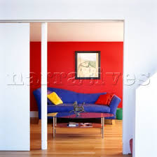 decor red blue room full: colourful red decor in modern living room with blue sofa and red and yellow cushions through