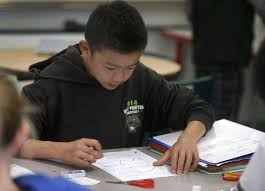 SF responds to parents in algebra dispute   SFGate SFGate Ethan Fong solves a math problem in Sarah Kochalko     s  th grade class at Herbert Hoover Middle