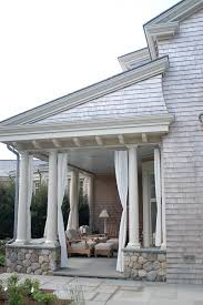 outdoor curtains porch beach style with shingle siding patio furniture beach style patio furniture