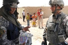 u s department of defense photo essay u s army 1st lt pete van hooser gives an i policeman handbills to distribute in