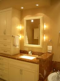 classy white finish varnished wooden vanity cabinet include stainless steel single faucet brown marble brown fabric lighting