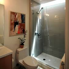 appealing small bathroom delightful small bathroom with shower bathtub ideas offer glossy white tub with conventional shower units surrounding smokey brown bathroom lighting ideas small bathrooms