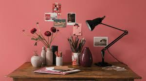 mix vintage shades to add artistic flair to a plain office space burnt red home office