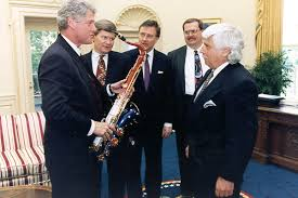 president bill clinton accepts the limited edition presidential model tenor saxophone built in his honor bill clinton oval office