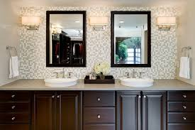 marvelous bathroom lighting sconces with dark stained vanity next to custom mirrors alongside with towel tack and demi vessel sink bathroom lighting sconces