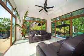 tropical living rooms: modern living room ceiling fan  tropical living room design