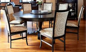 round dining room table sets white varnished wooden dining table black modern dining chair white wood and metal cabinets cream fabric area carpet gray black wood dining room