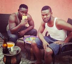 Image result for picture of flavor the nigerian musician eating local food