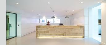 we found some railway sleepers had them polished and stained and made them into a simple reception counter the client still loves it best office reception areas
