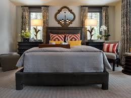 master bedroom master bedroom with gray bedding and vibrant pillows hgtv with regard to master bedroom furniture makeover image14
