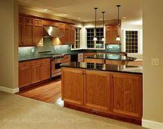 kitchen cabinets with granite countertops: black granite countertops with oak kitchen cabinets
