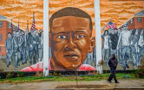 freddie gray dies in police custody in baltimore a man who declined to offer his walks past a mural of freddie