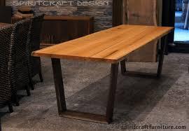 walnut cherry dining: edge  cherry live edge slab dining table with walnut mid century modern trapezoid legs from spiritcraft design furniture dundee illinois