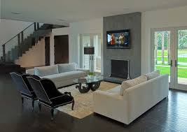 contemporary living room trendy living room photo in other with a standard fireplace a wall mounted blue dark trendy living room