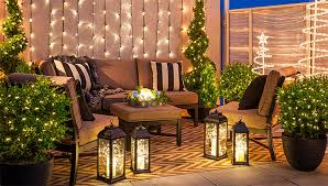 outdoor christmas lighting on balcony with white string lights lanterns spiral trees and lighted balcony lighting ideas