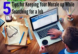 tips for keeping your morale up during job search jobtreks man applying for a job on the internet job searching