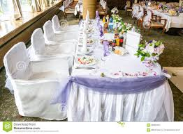 images fancy party ideas: white wedding party table with fancy chairs and a lot of flowers