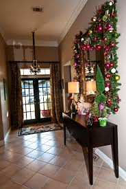 brilliant garland mirror decors over black wood rectangle desk added lighting ideas as inspiring christmas foyer decorating ideas alluring closet lighting ideas