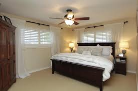 traditional window treatment idea feat black wood bed frame design plus unique ceiling fan with lights ceiling lighting for bedroom