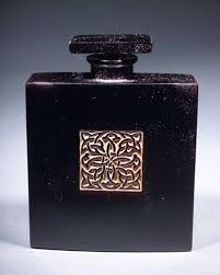 """Poeme Arabe,"" a perfume bottle for Lionceau, circa 1928, in black ..."
