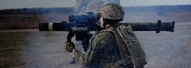 marine corps roles positions career divisions com a marine fires a weapon as debris fills the air