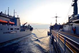 u s department of defense photo essay the submarine tender uss frank cable right conducts a replenishment the military sealift
