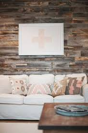 rustic style living room clever: stikwood accent wall west elm pillows in a cozy living roomi love the pic in the back ground would make a great gift to my sister who is an or nurse