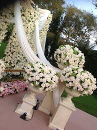 kim kardashian wall of roses wedding decor backdrop bay area uplighting wedding