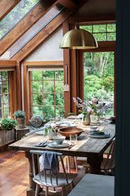 style sunroom great cottage decor a brass pendant light over the farm table adds a modern touch to this