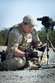u s department of defense photo essay a special forces ier calculates adjustments using atmospheric data as a spotter for his teammate firing