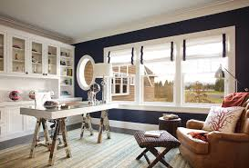west coast hampton beach style home office idea in portland with blue walls dark hardwood floors blue white office space