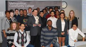 mcc students learn the value of networking at burns mcdonnell an mcc trophy of appreciation and mcc business technology president dr jackie gill left are shown students in the early college program