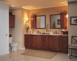 built bathroom vanity design ideas: traditional master bathroom brown glossy wood storage cabinet vanilla granite countertop khaki tan medium rectangular