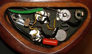 "50s wiring for epiphone and gibson bridge controls this was bright originally so i wanted to increase the capacitor to a 047 uf a buddy had a spare ""orange drop"" in 047 uf"
