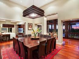 dining room large formal tables with beautiful flower arrangement and square rugs mrs wilkes dining beautiful dining room furniture