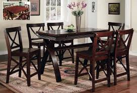 dining room pub style sets: elegant dining room design with dark cherry pub tables set cross trestle rectangular wooden table and tall silver flower vase centerpiece decoration