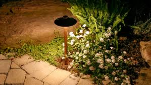 elegant copper path light revealing flower beds in a northern nj garden stairs lighting area lighting flower bed