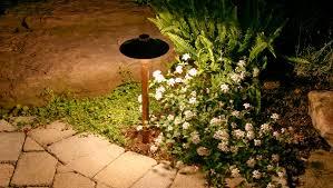 elegant copper path light revealing flower beds in a northern nj garden amazing garden lighting flower