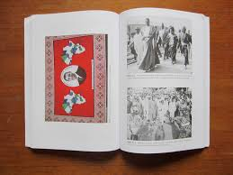 book review african dress worn through color plate featuring commemorative obama fabric facing two black and white figures from